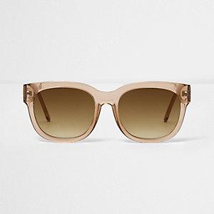 Lichtbruine oversized zonnebril met doorzichtige grijze glazen