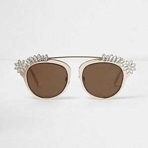 Goldene, verzierte Sonnenbrille