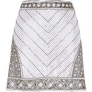 Mini-jupe blanche ornée