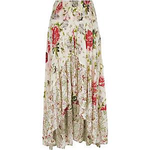 Jupe longue asymétrique à fleurs blanche ornée de sequins