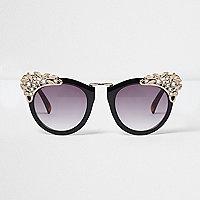 Schwarze große Sonnenbrille mit Verzierung