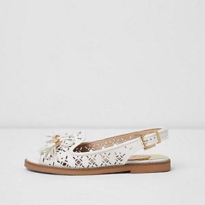 White laser cut tassel slingback loafers