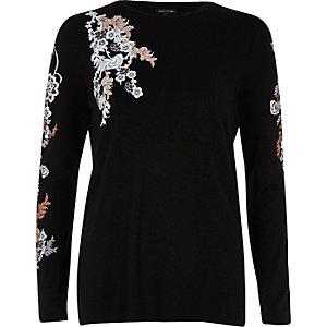 Zwarte top met lange mouwen en bloemenprint