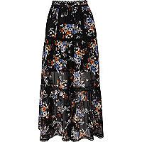 Jupe longue en mousseline à fleurs noire à volants