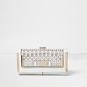White laser cut metallic clip top purse