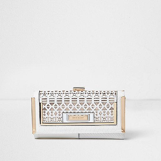 White laser cut metallic clip top purse