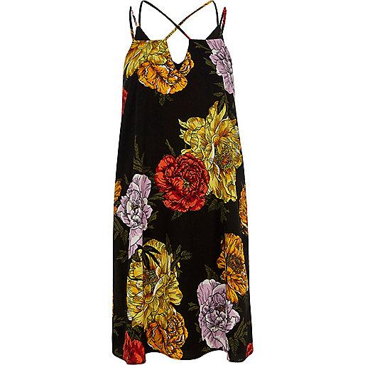 Zwarte slipdress met bloemenprint en gekruiste bandjes