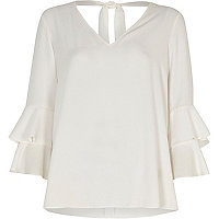 White double bell sleeve top