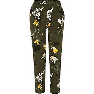 Pantalon slim fuselé à fleurs kaki