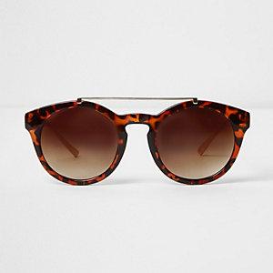 Bruine ronde tortoise zonnebril met neusbrug