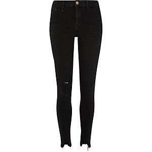Black chewed hem skinny Molly jeggings