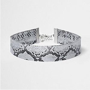 Ras-de-cou motif serpent blanc métallisé