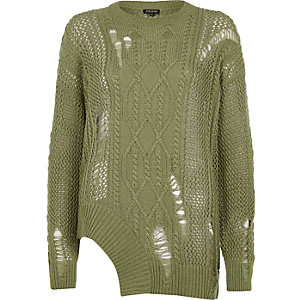 Green cable knit laddered cut out hem jumper