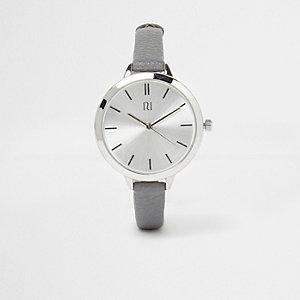 Grey skinny strap silver tone watch