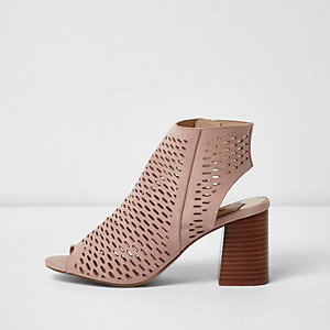 Light pink laser cut block heel sandals