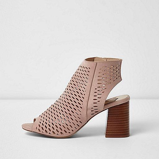 Light pink laser cut block heel sandals