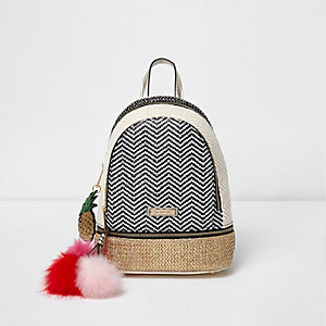 Black woven pom pom mini backpack