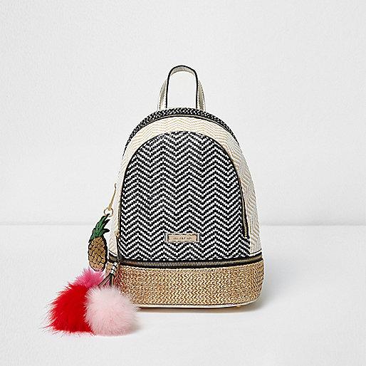 Black woven pom pom mini backpack
