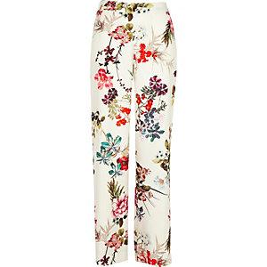 Witte broek met wijde pijpen en bloemenprint