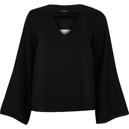 Black twist back bell sleeve top