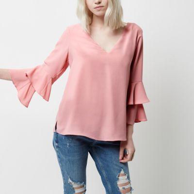 RI Petite Roze top met dubbele klokmouwen en strik achter
