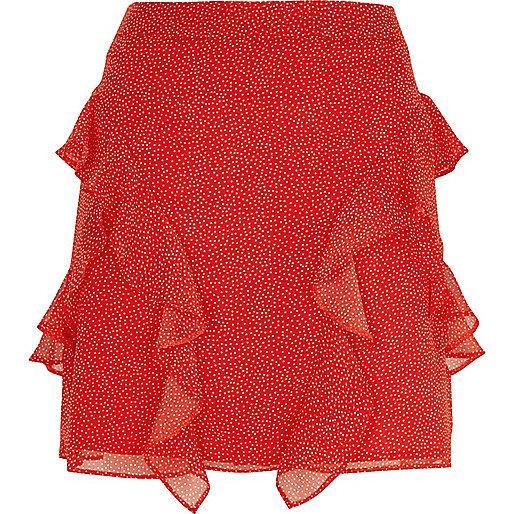 Mini-jupe à pois rouge à volants