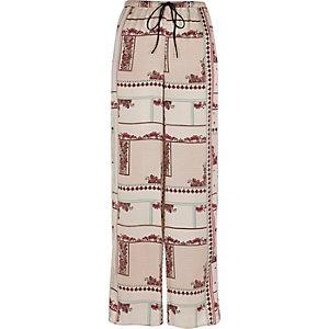 Crème palazzo pyjamabroek met wijde pijpen en bloemenprint