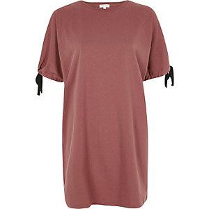 Donkerroze oversized T-shirt met strikjes aan de mouwen