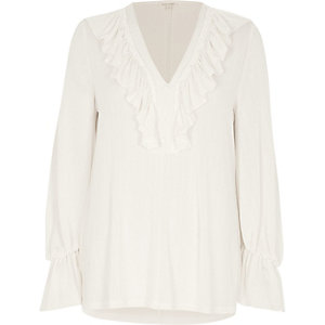 Cream frill V neck long sleeve blouse