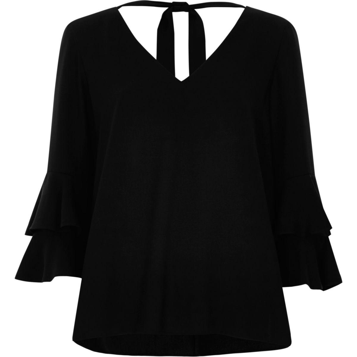 Zwarte top met V-hals, klokkende mouwen en strik achter