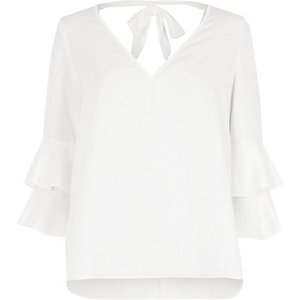 White double bell sleeve tie back V neck top