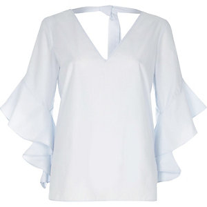 Light blue ruffle sleeve tie back V neck top