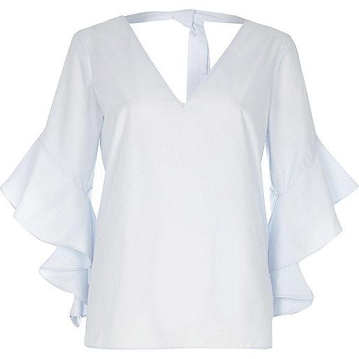Light blue ruffle sleeve tie back V neck top