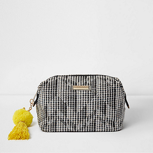 Black woven pom pom make-up bag