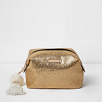 Gold woven pom pom make-up bag