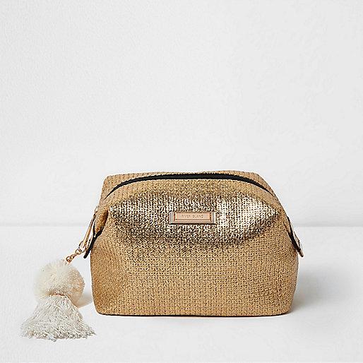 Gold woven pom pom make-up bag