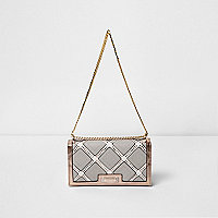 Beige laser cut underarm chain bag