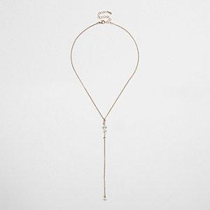 Gold tone diamante snake drop necklace