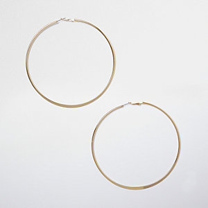 Gold tone large hoop earrings