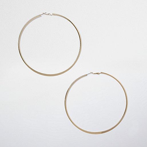 Gold tone large hoop earrings