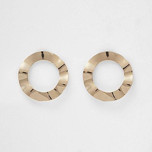 Gold tone wave circle stud earrings
