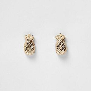 Clous d'oreilles dorées motif ananas