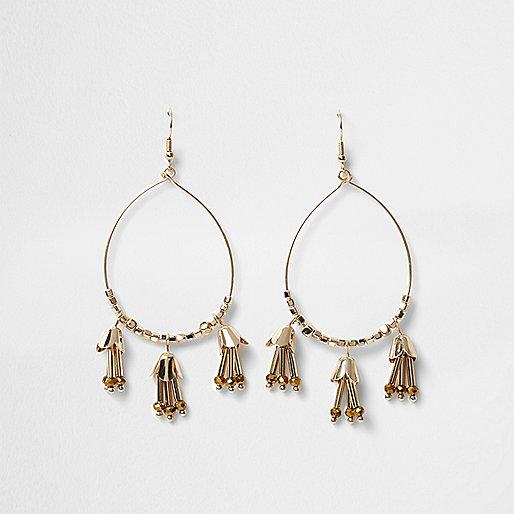 Gold tone tassel hoop drop earrings