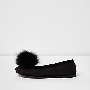 Black pom pom ballet pumps