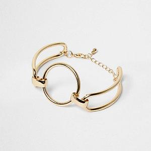 Gold tone circle cuff bracelet