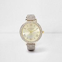 Grijs gewatteerd horloge met ingelegde siersteentjes