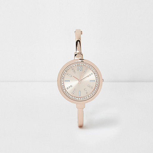 Rose gold tone rhinestone round watch
