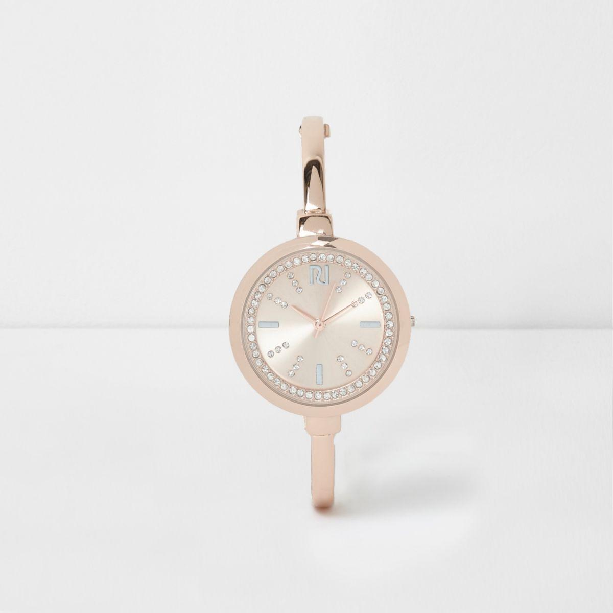 Rose gold tone rhinestone round watch