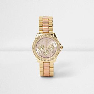 Strassverzierte Armbanduhr in Roségold und Gold