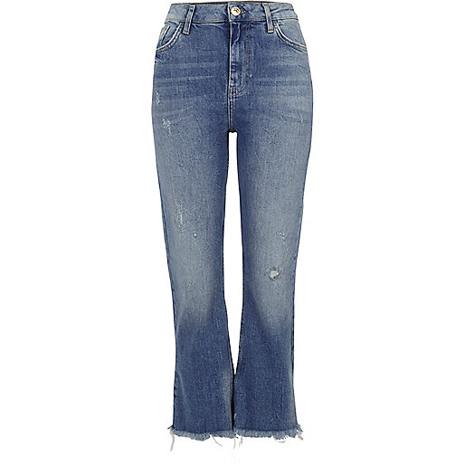 Blue distressed cropped flared jeans